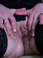 This horny mature slut plays with her toy