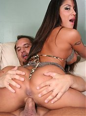 Buxom Latina Jenaveve Jolie exposes her sunkissed ass while she takes on a big wang