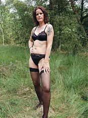 Sexy mature cam model strips down and masturbates outdoors during a webcam session