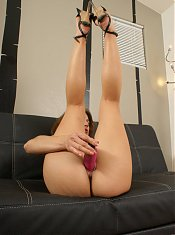 Mature hottie Trixie strips down and lubricates a dildo before sliding it inside her ass