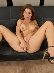 Miss Trixie takes her clothes off and relaxes on the couch while playing with a dildo