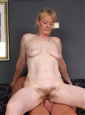 Naughty granny Maria taking her clothes off to lure a younger guy into fucking her live